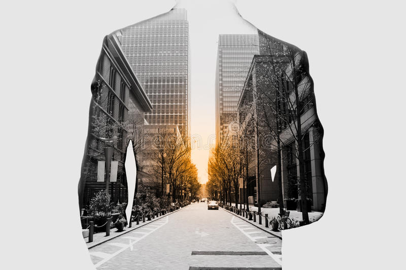 Двойная экспозиция бизнесмена и городского пейзажа стоковые изображения rf