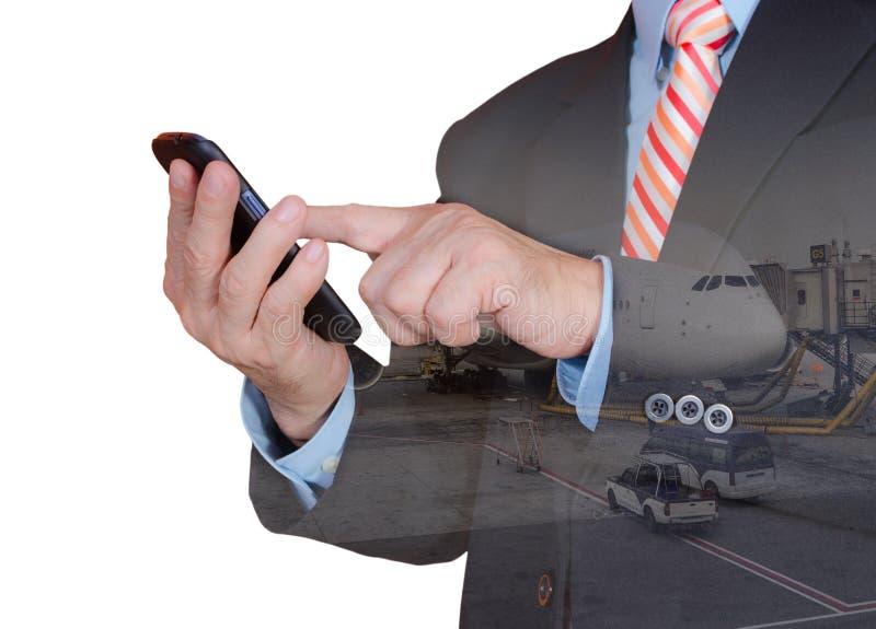 Двойная экспозиция владения руки и smartphone экрана касания стоковое фото rf