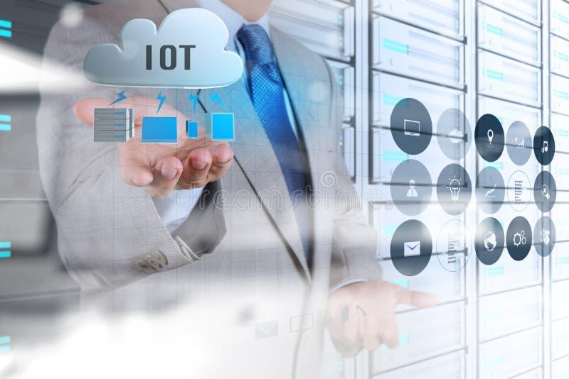 Двойная экспозиция руки показывая интернет вещей (IoT) стоковая фотография rf