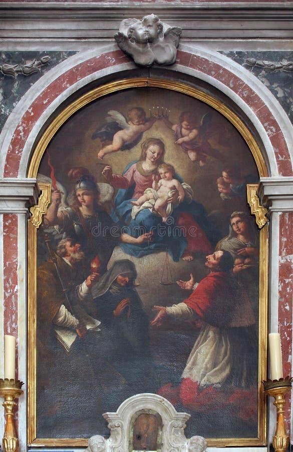 Дева мария с младенцем Иисусом и Святыми стоковая фотография
