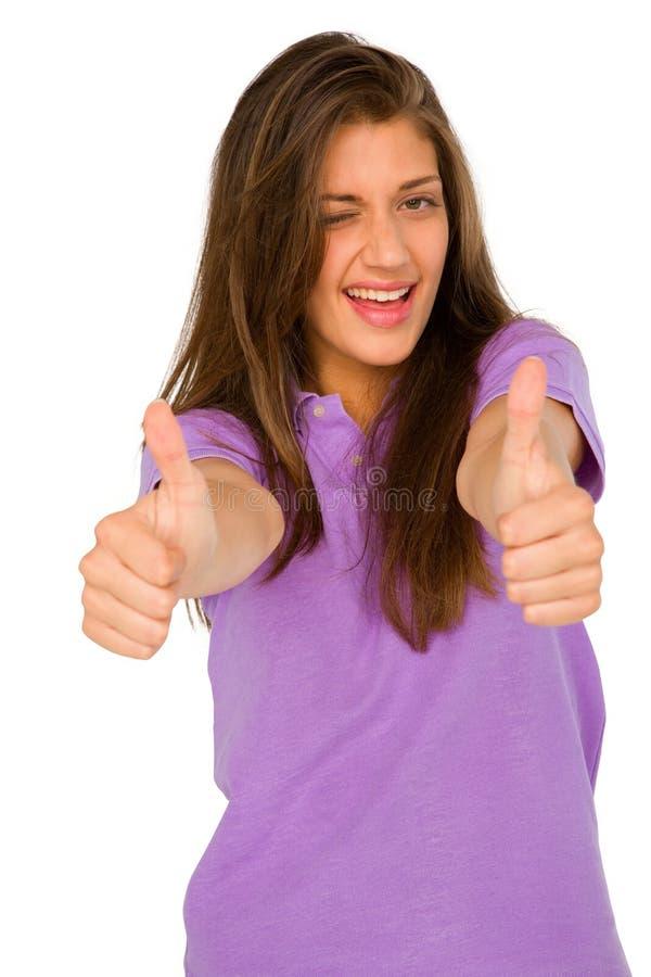 Девочка-подросток с большими пальцами руки вверх подмигивая стоковые фото