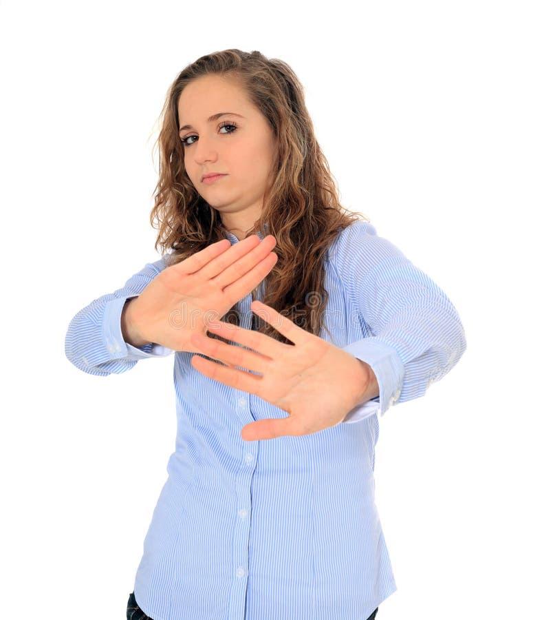 Девочка-подросток с отталкивать жестом стоковые изображения rf