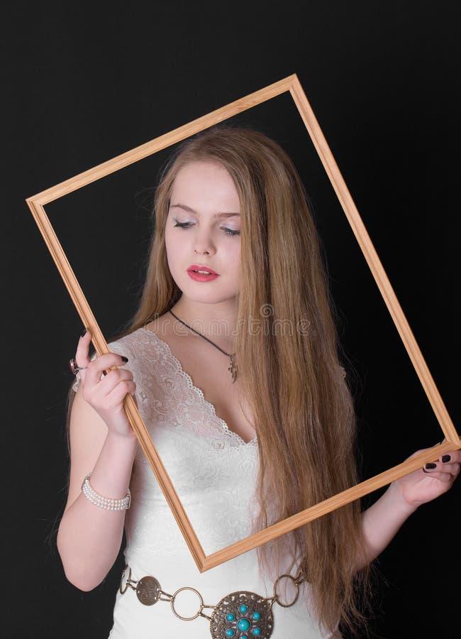 Девочка-подросток в рамке стоковые фото