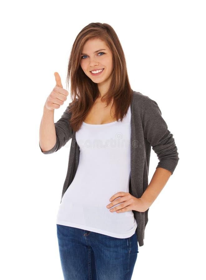 Девочка-подросток показывая большие пальцы руки вверх стоковое фото rf