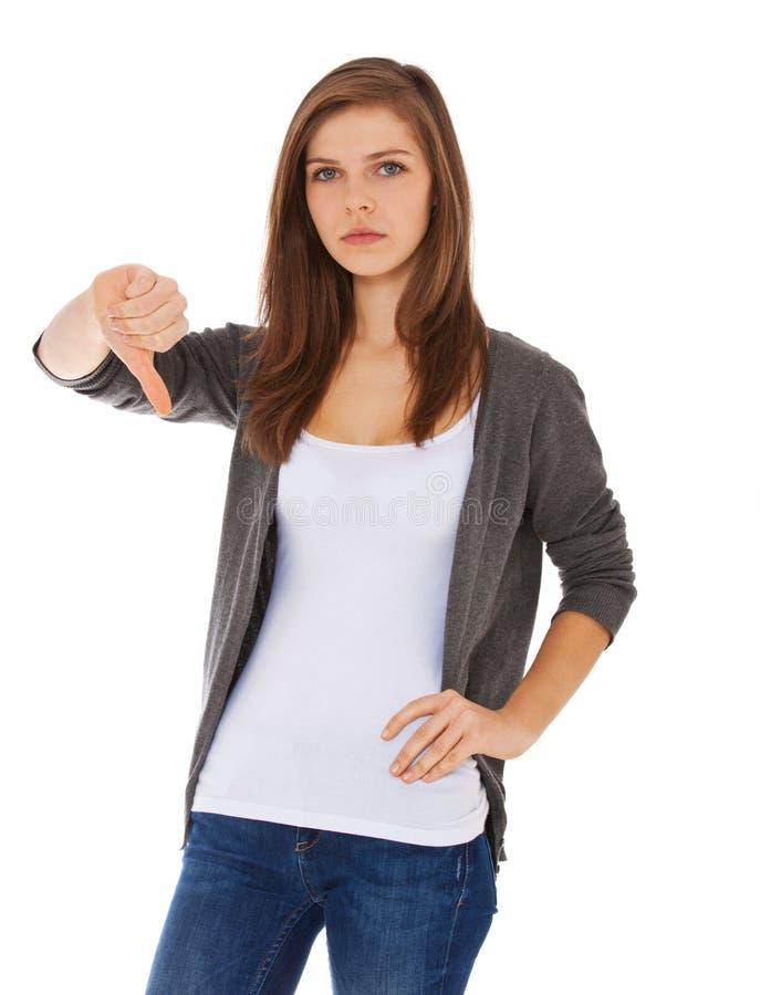 Девочка-подросток показывая большие пальцы руки вниз стоковое изображение