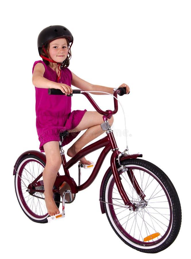 девушка велосипеда она стоковая фотография rf