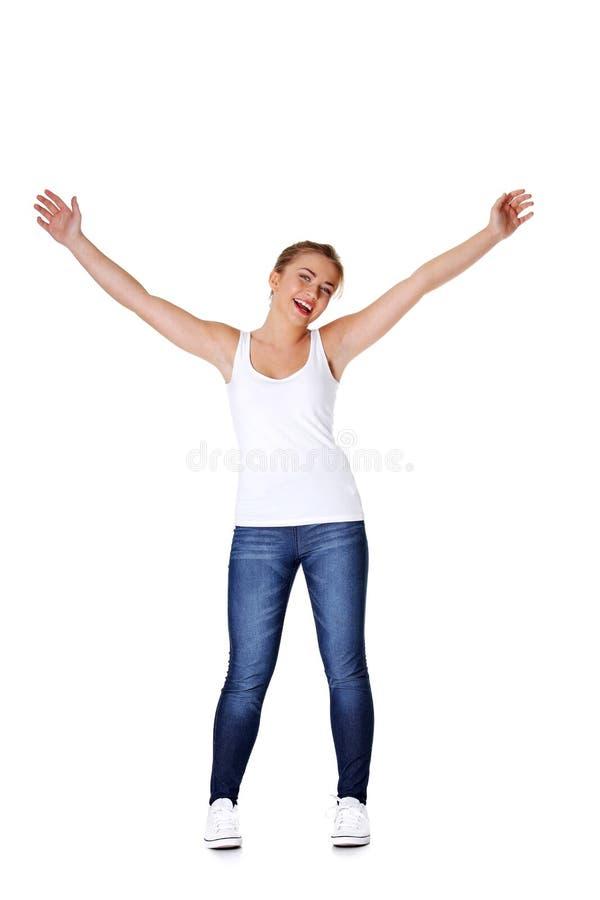девушка вручает ее предназначенное для подростков поднимающее вверх стоковая фотография rf