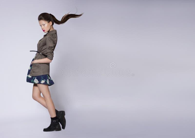 Девушка в без сокращений куртке стоковые фотографии rf