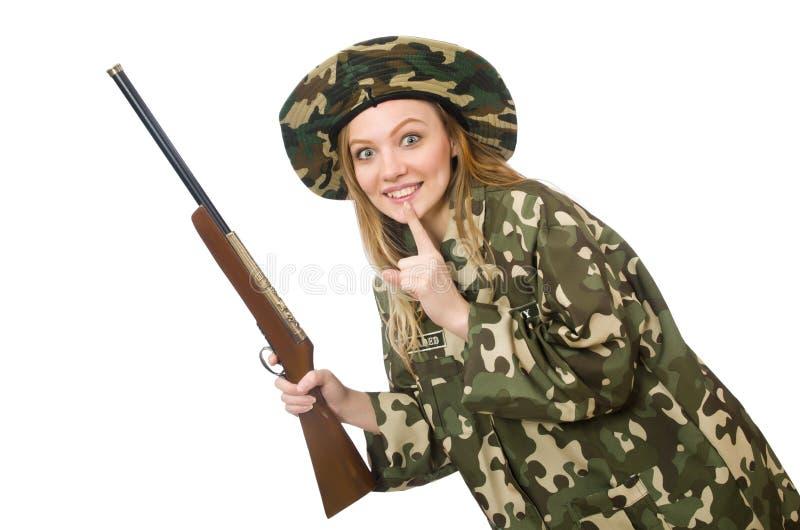 Девушка в военной форме держа оружие изолированный на белизне стоковая фотография
