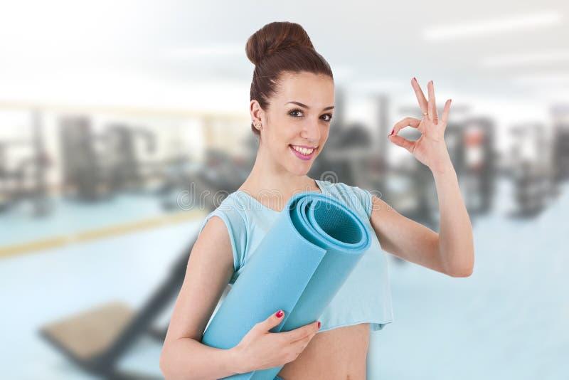 Девушка в гимнастике стоковое фото rf