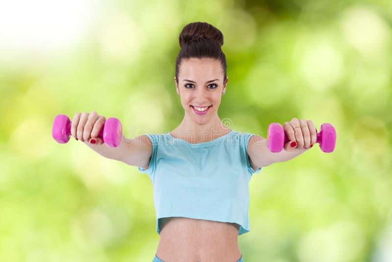 Девушка в гимнастике стоковое изображение