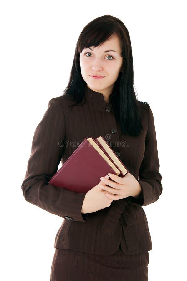 Девушка в деловом костюме с книгами стоковая фотография