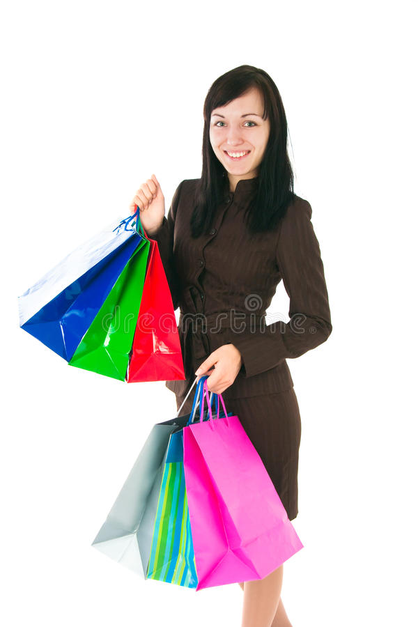 Девушка в деловом костюме с приобретениями стоковые изображения rf