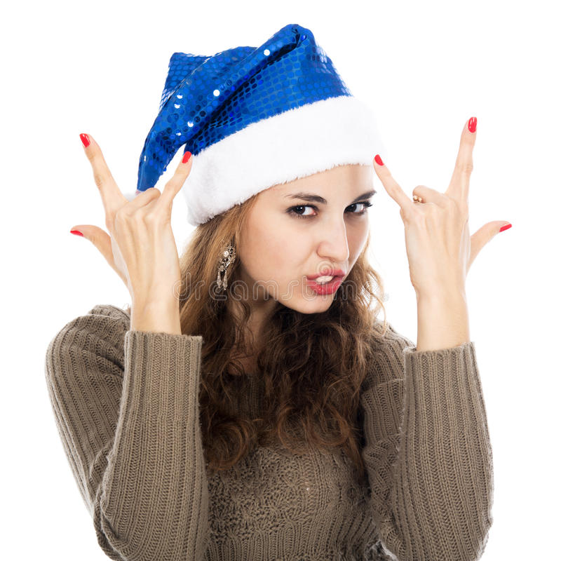 Девушка в козах шляпы santa показывая утес-n-крен подписывает стоковое изображение