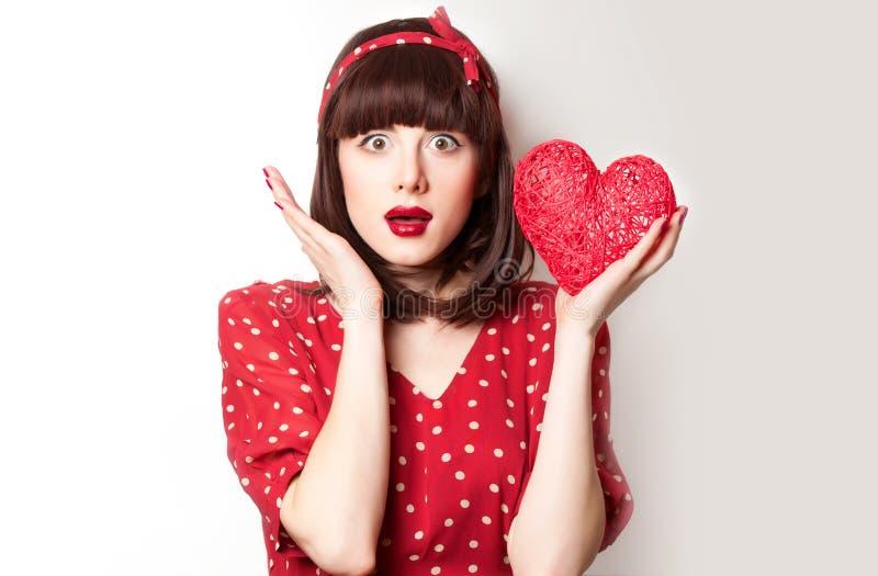 Девушка в красном платье с игрушкой стоковое фото