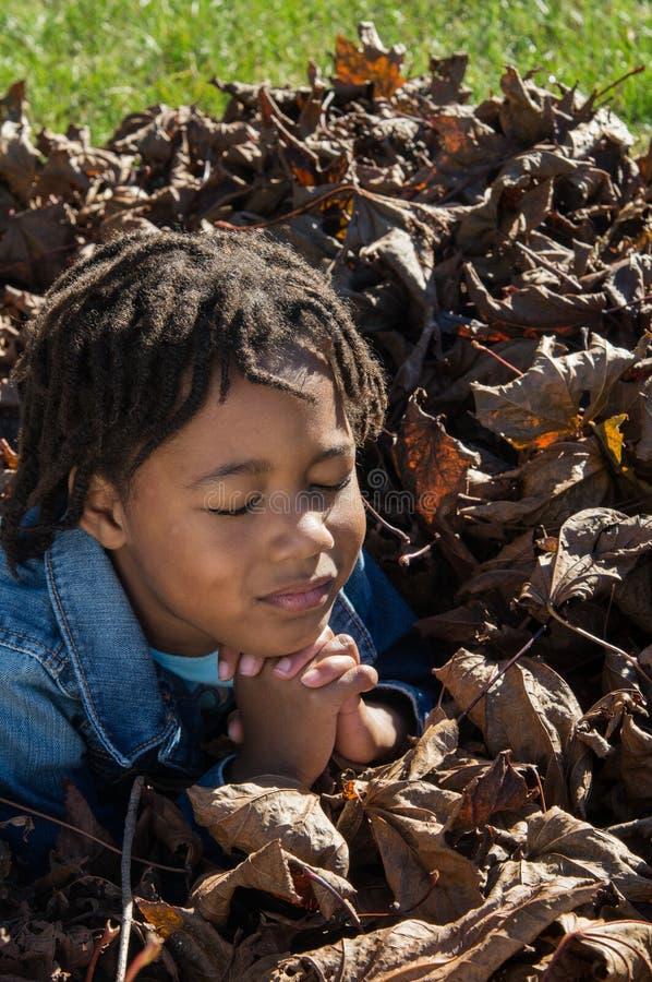 Девушка в молитве стоковая фотография rf