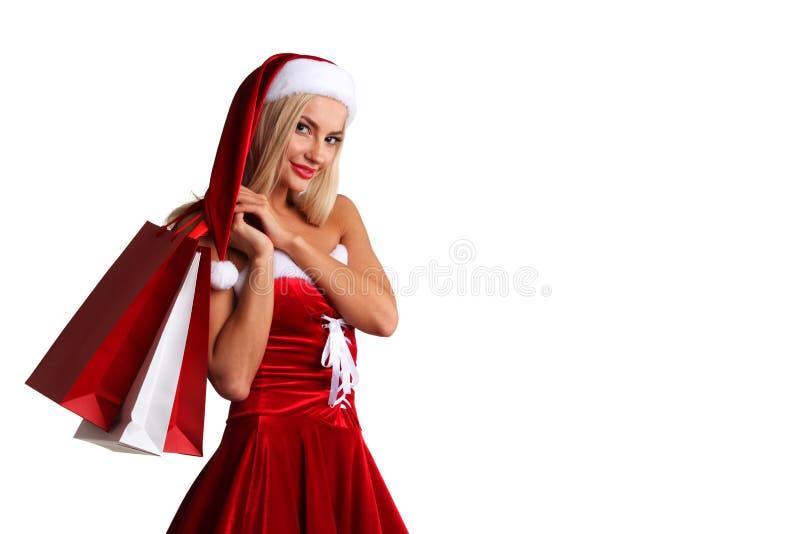 Девушка в покупках костюма Санта Клауса стоковая фотография rf