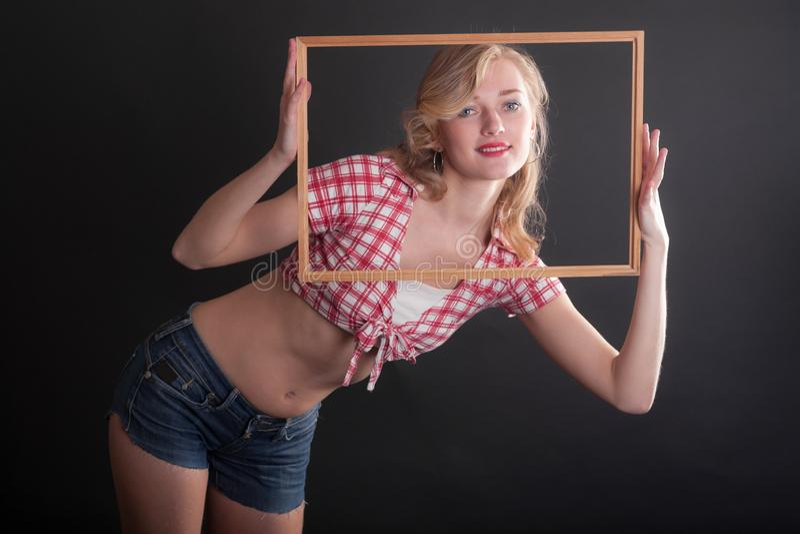 Девушка в рамке стоковая фотография
