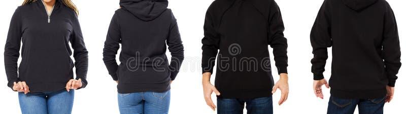 Девушка в черной фуфайке с назад изолированными клобуком и человеком во фронте фуфайки и, модель-макет hoodie пустой стоковая фотография rf