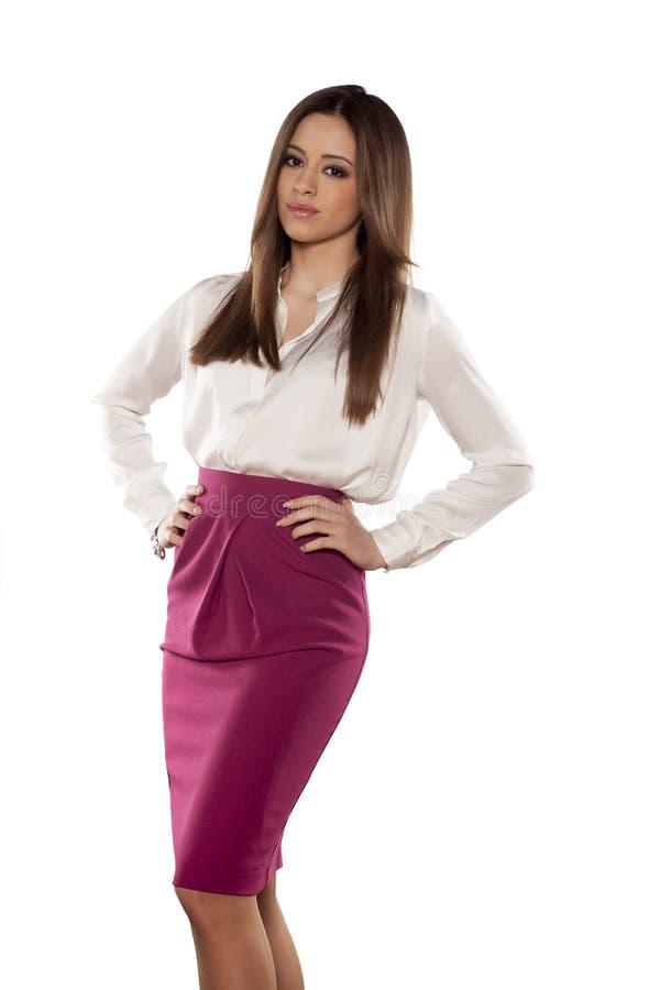 Девушка в юбке и рубашке стоковые изображения