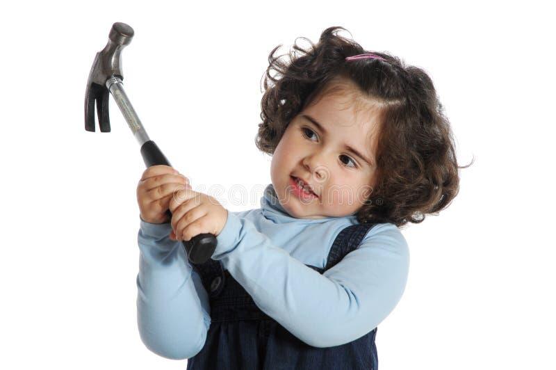девушка держа маленькие инструменты стоковое изображение rf