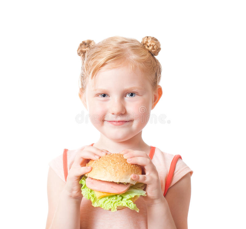 девушка еды счастливая стоковое изображение