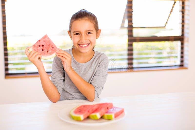 Девушка держа арбуз стоковое фото rf