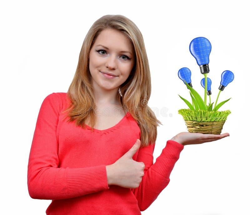 Download Девушка держа в шариках энергии Eco руки Стоковое Изображение - изображение насчитывающей concept, расти: 33727805