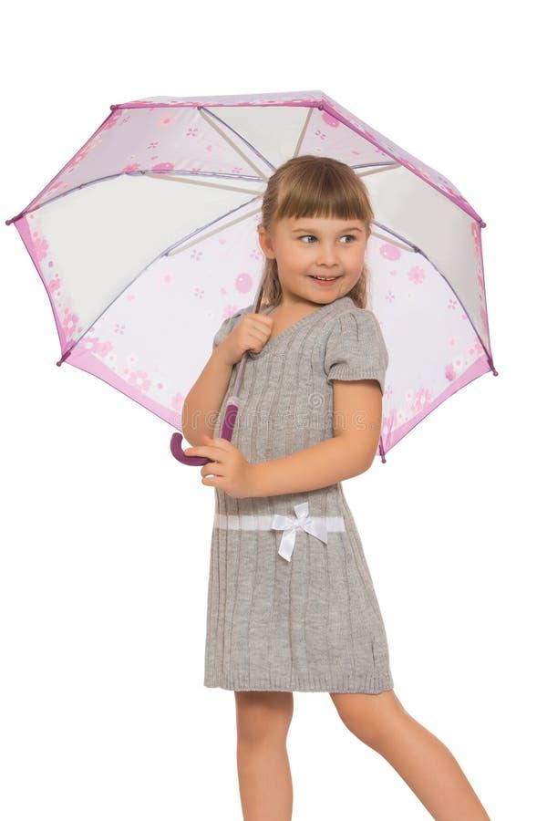 Девушка держа зонтик стоковое изображение rf