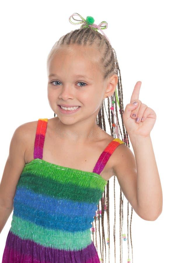 Девушка держа указательный палец вверх стоковая фотография rf