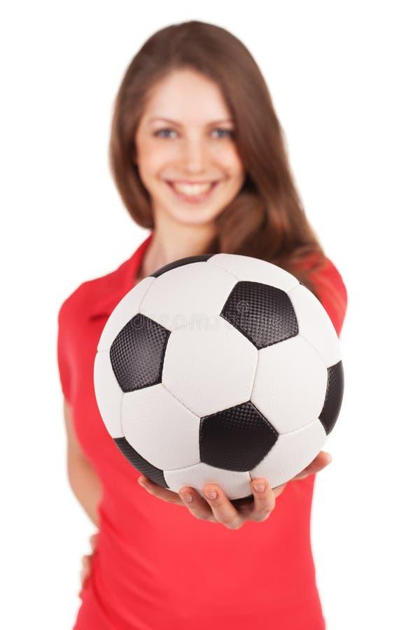 Девушка держа шарик футбола стоковое изображение