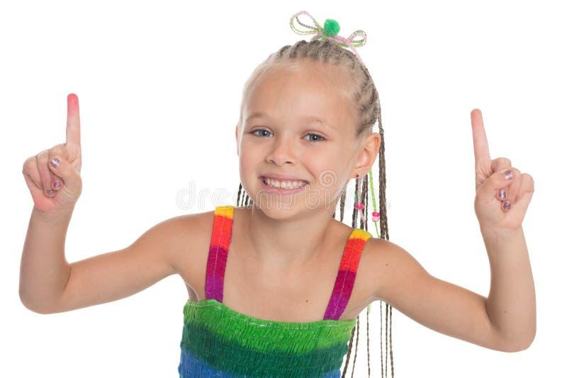 Девушка задерживая указательные пальцы стоковое фото