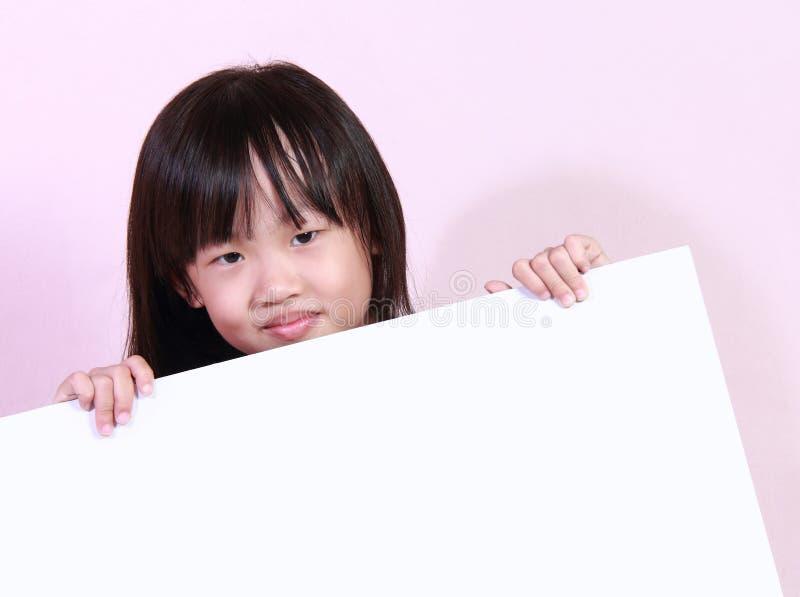 Девушка и белая доска стоковая фотография rf