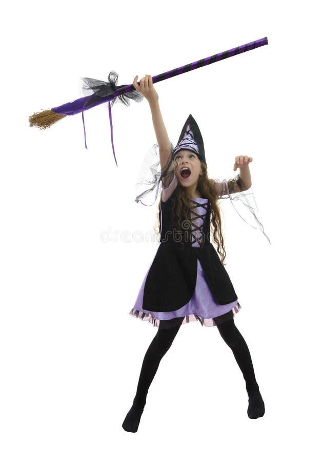 Девушка и веник ведьмы стоковое фото