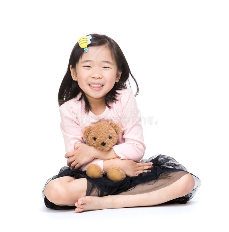 Девушка и кукла стоковые фотографии rf