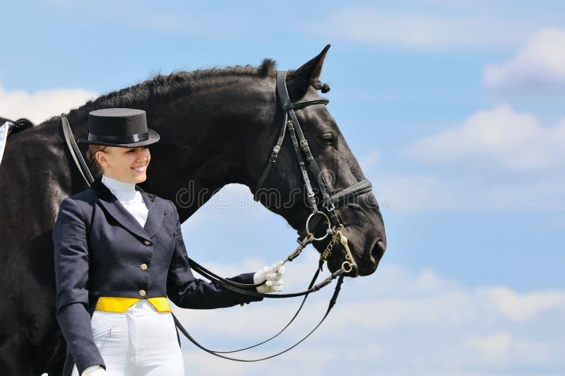 Девушка и лошадь dressage стоковая фотография rf