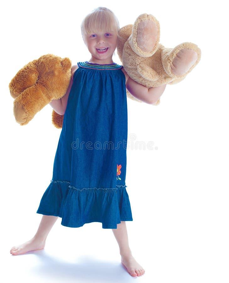 Девушка и медведь стоковые изображения