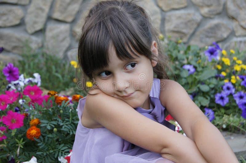 Девушка и цветки стоковое фото
