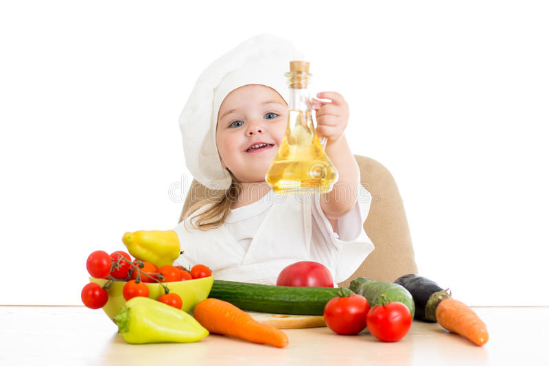 Девушка кашевара с здоровой едой стоковые фотографии rf