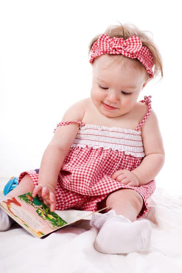 девушка книги немногая стоковое изображение rf