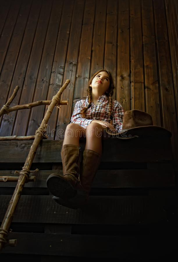девушка ковбоя немногая стоковое фото