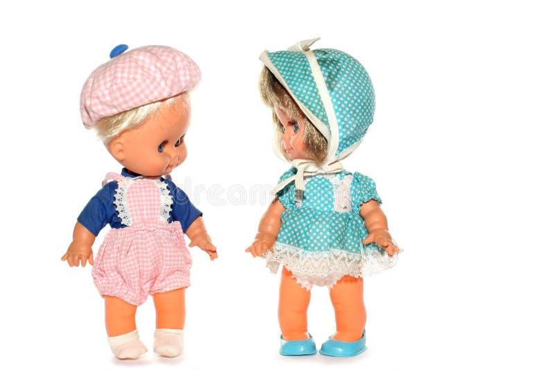девушка куклы мальчика счастливая стоковые изображения