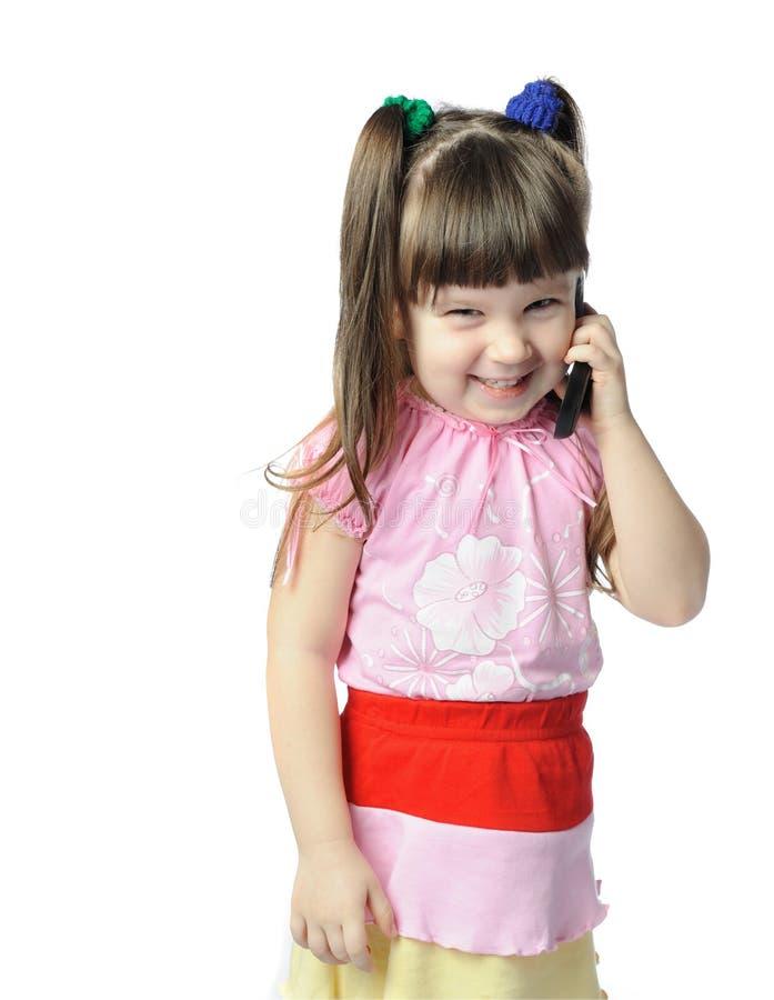 девушка меньший мобильный телефон стоковые изображения rf