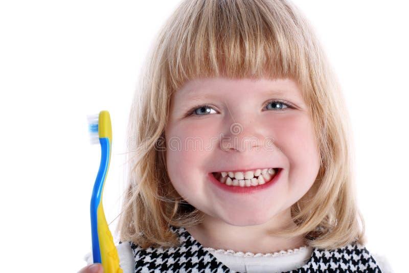 девушка меньшяя зубная щетка стоковая фотография
