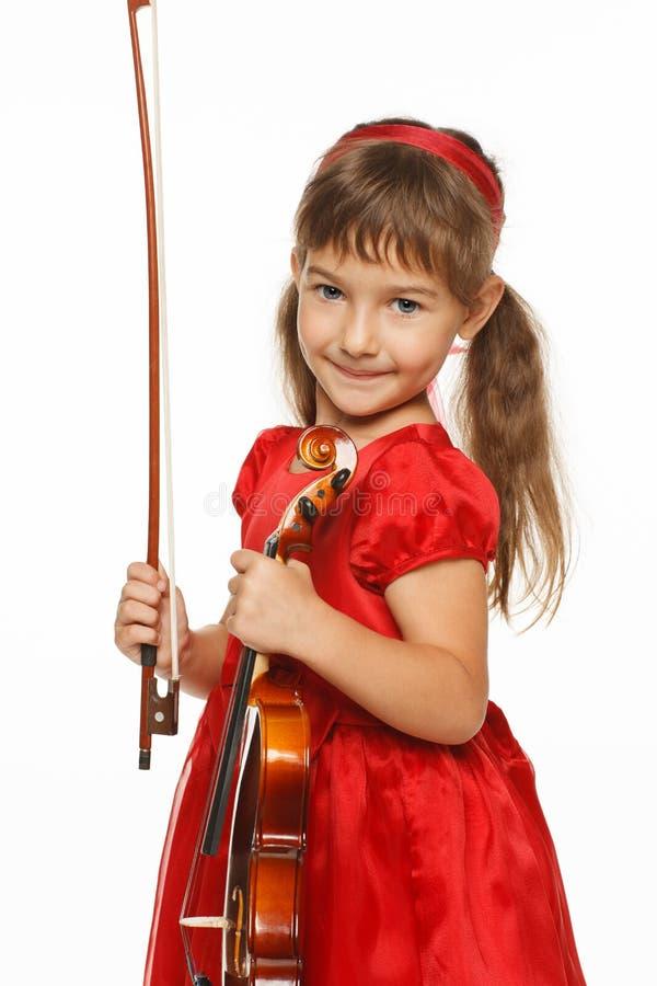 девушка меньшяя скрипка стоковое фото rf
