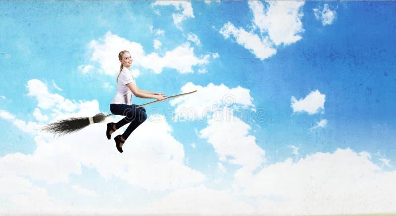 Девушка на венике стоковое изображение
