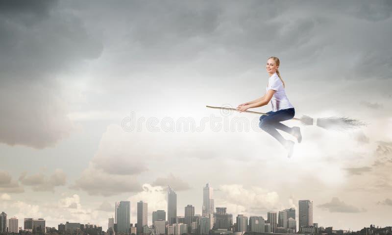 Девушка на венике стоковая фотография rf