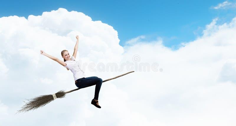 Девушка на венике стоковое изображение rf
