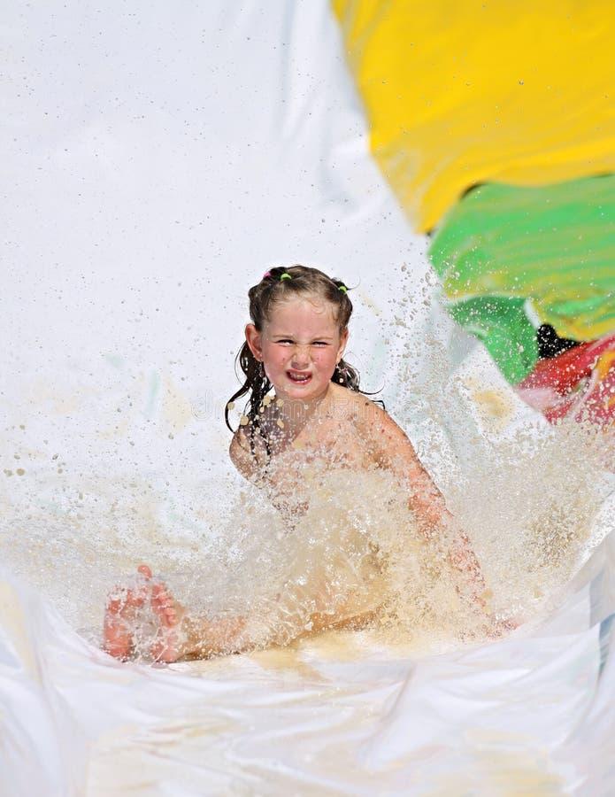 Девушка на скольжении стоковое изображение