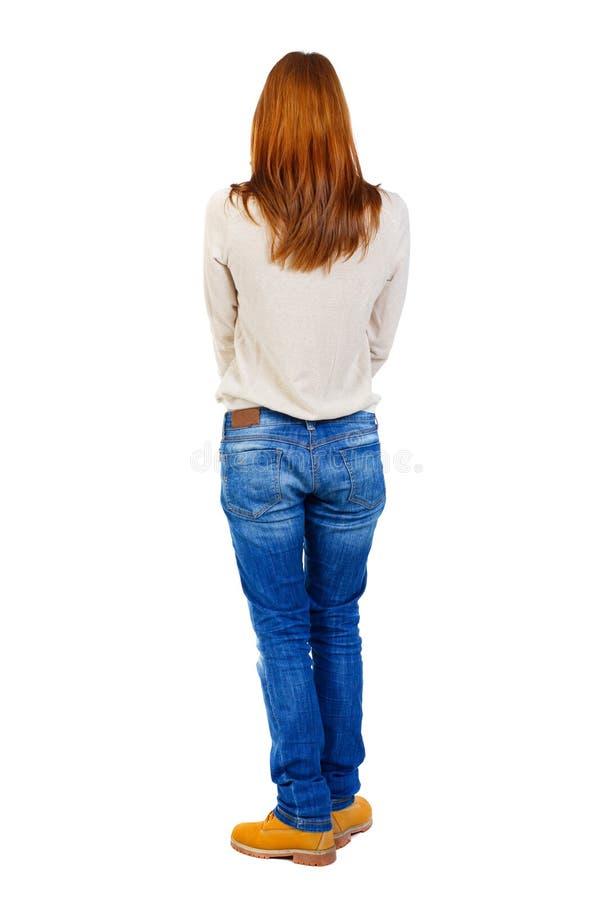 Девушка носит тяжелую кучу книг задний взгляд стоковая фотография